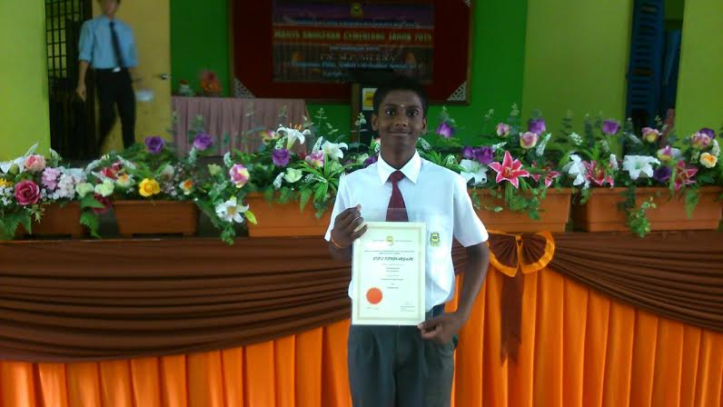 Mohan and his certificate for having shown most improvement in school