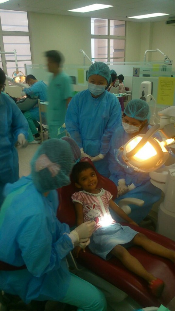 A child from the Hiichiikok Foundation Home For Children Care getting dental check-up at the SEGi Oral Health Centre