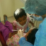 A child from the Hiichiikok Foundation Home For Children Care offering words of encouragement to her friend during a dental check-up at the SEGi Oral Health Centre